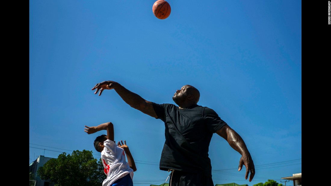 NBA Hall of Famer Shaquille O'Neal plays basketball during a clinic with young players in Havana, Cuba, on Sunday, June 26.