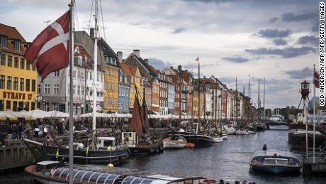 A sightseeing vessel is seen at Nyhavn canal in Copenhagen on October 9, 2015. Hosting historical wooden ships, the 17th-century waterfront, canal and entertainment district is popular with tourists visiting the Danish capital. AFP PHOTO / ODD ANDERSEN        (Photo credit should read ODD ANDERSEN/AFP/Getty Images)