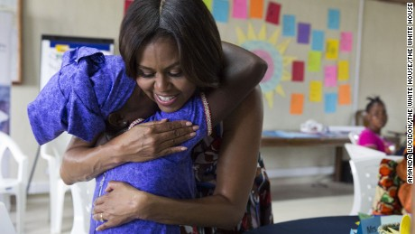 Michelle Obama hugs a student following a lesson plan about girls' leadership and self-esteem in support of the Let Girls Learn initiative, in Kakata, Liberia, June 27.