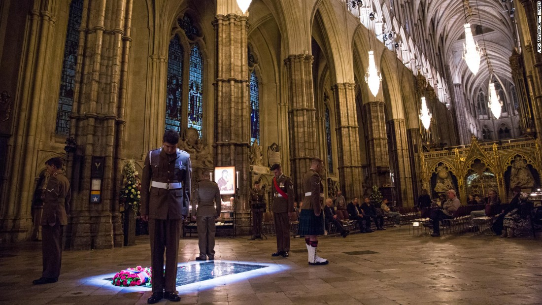British Military personnel stand at the Grave of the Unknown Warrior during an overnight vigil to commemorate the centenary of the Battle of the Somme at Westminster Abbey  in London, England. The Grave of the Unknown Warrior contains the body of an unidentified British solider from World War I buried in French soil and covered with a Belgian marble slab.