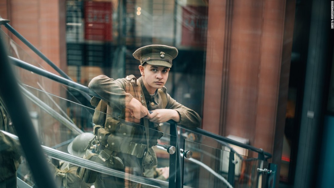 The photos of modern men dressed in old uniforms were posted on social media with #WeAreHere.