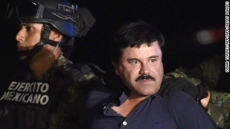 Guzman is escorted into a helicopter following his recapture in 2016.