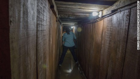 A journalist walks along a tunnel through which Guzman tried to escape.