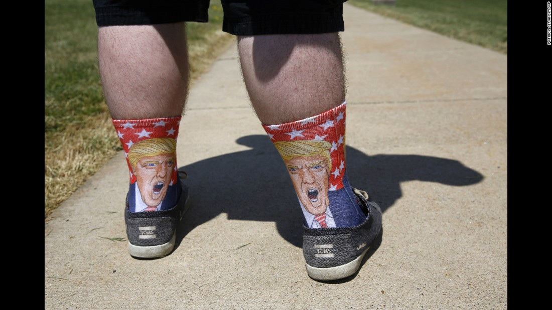 Evan Hubert wears socks depicting Republican presidential candidate Donald Trump as he waits to attend a Trump rally in St. Clairsville, Ohio, on Tuesday, June 28.