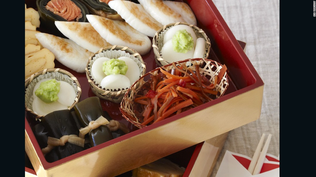 Special dishes eaten during the New Year holidays are collectively called osechi. Arranged in a multi-tiered jubako box, the distinctive menu offers glimpses into Japan's culinary culture. Tiny pieces of shake no kobu maki -- salmon-stuffed kelp rolls -- are included in this one, as seen in the lower left corner of the box.