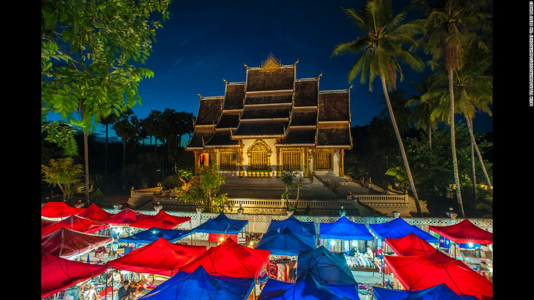 """A combination of French, Chinese and Vietnamese cultures<a href=""""http://whc.unesco.org/en/list/479"""" target=""""_blank""""> that is also a UNESCO World Heritage Site, </a>Luang Prabang, Laos is """"a wonderfully serene town, at the confluence of the Mekong and Nam Khan rivers. You can wander around the city, gaze at the gold-plated temples, shop for hand-woven silk, and eat incredible Laotian food—for relatively little money."""" The Hmong night market includes a view of Haw Pha Bang temple."""