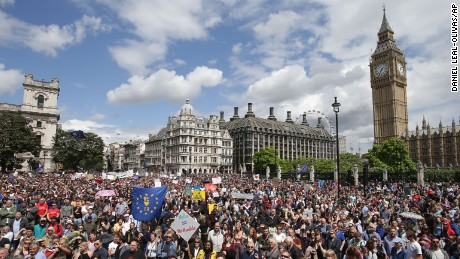 """Remain"" supporters demonstrate in Parliament Square, London, to show their support for the European Union in the wake of the referendum decision for Britain to leave the EU, known as ""Brexit"", Saturday July 2, 2016. Demonstrators wearing EU flags as capes and with homemade banners saying ""Bremain"" and ""We Love EU"" gathered on the streets for the March for Europe rally. At rear right is the Elizabeth Tower containing Big Ben. (Daniel Leal-Olivas/PA via AP)"