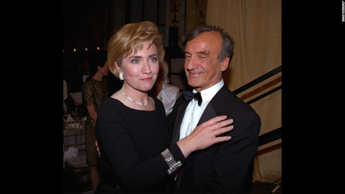 Elie Wiesel stands with then-first lady Hillary Clinton following her acceptance of the Humanitarian Award from the Elie Wiesel Foundation in New York on  April 14, 1994.