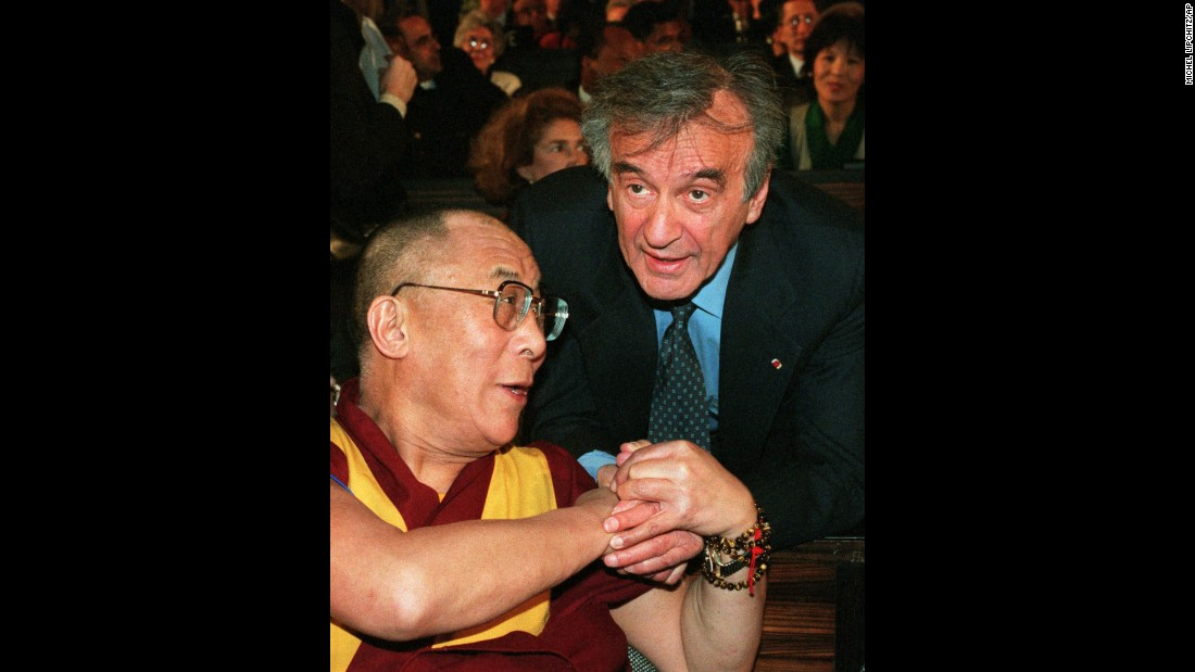 Nobel Peace Prize laureate Elie Wiesel, right, appears with the spiritual leader of Tibet, the Dalai Lama, during a ceremony for the 50th birthday of the Universal Declaration of Human Rights in Paris on December 7, 1998.