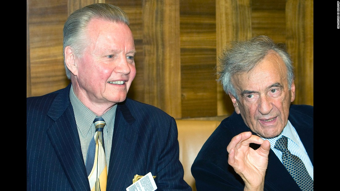 "Nobel laureate Elie Wiesel, right, and actor Jon Voight, left, wait for the beginning of a conference on ""Lessons of the Holocaust for Antisemitism and Intolerance in the 21st Century"" at the United Nations office in Geneva, Switzerland, in 2009."