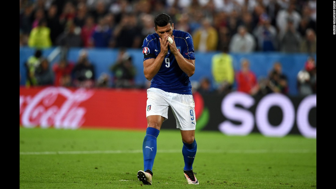 Graziano Pelle of Italy reacts after missing his penalty shot.