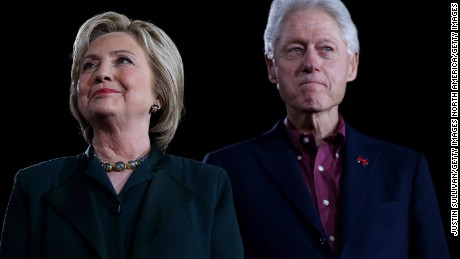 """LAS VEGAS, NV - FEBRUARY 19:  (L-R) Democratic presidential candidate former Secretary of State Hillary Clinton and her husband, former U.S. president Bill Clinton look on during a """"Get Out The Caucus"""" at the Clark County Government Center on February 19, 2016 in Las Vegas, Nevada. With one day to go before the Democratic caucuses in Nevada, Hillary Clinton is campaigning in Las Vegas.  (Photo by Justin Sullivan/Getty Images)"""
