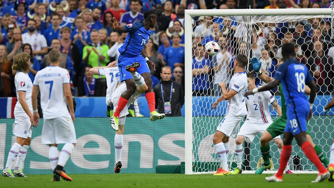 Paul Pogba, fourth from left, of France heads the ball to score his team's second goal.