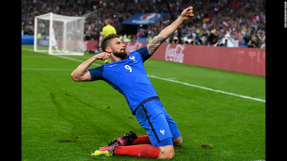 Olivier Giroud of France celebrates scoring his team's fifth goal during quarterfinal match between France and Iceland on Sunday, July 3, in Paris.