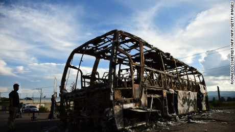 A burned vehicle is pictured at the entrance of the village of Nochixtlan, Oaxaca State, Mexico on July 3, 2016.  Ten people died and more than 100 were injured on June 19, in the southern state of Oaxaca, where the radical CNTE teachers union has blocked roads in protest against President Enrique Pena Nieto's education reform. / AFP / RONALDO SCHEMIDT        (Photo credit should read RONALDO SCHEMIDT/AFP/Getty Images)
