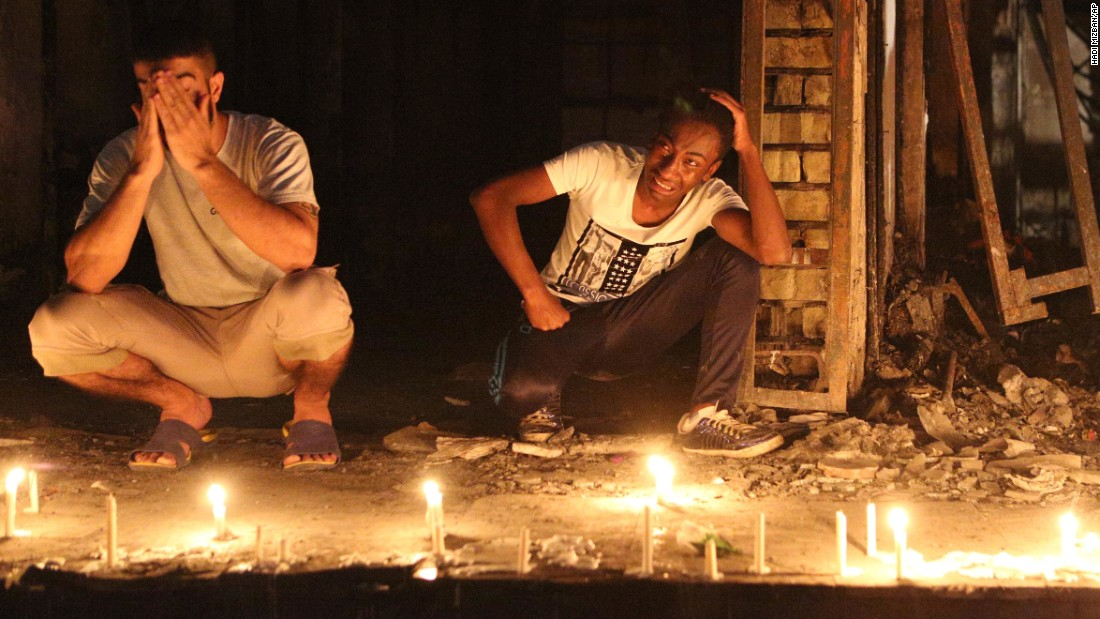 People light candles at the scene of the Karrada bombing.