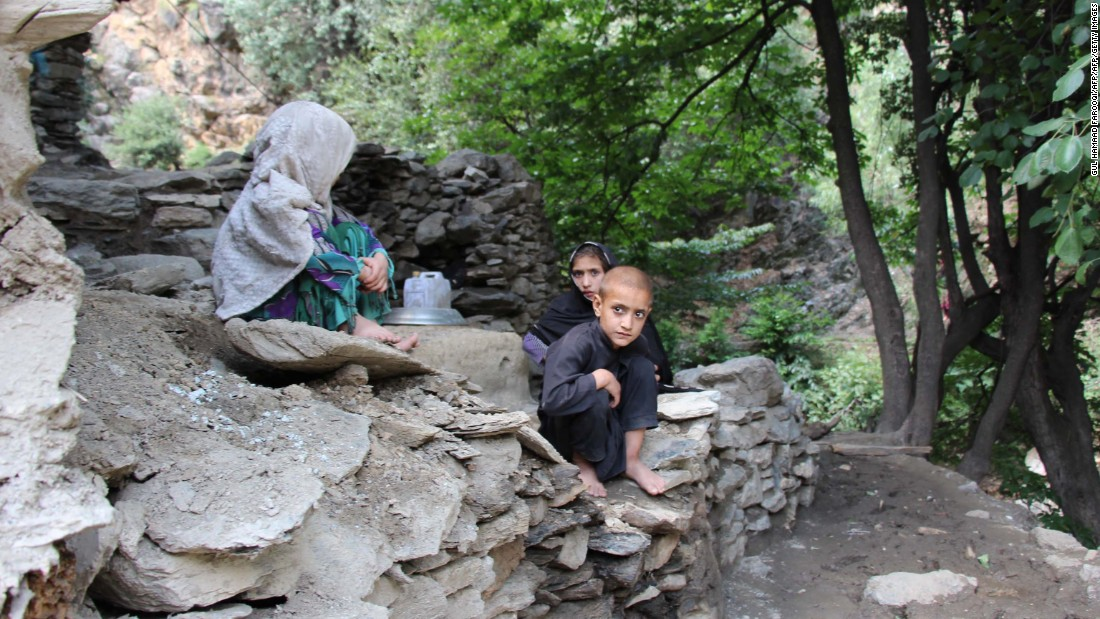 Children by a destroyed house after flash floods devastated Ursoon, a village near Chitral, on July 3, 2016.