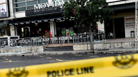 A general view of the site of a grenade attack at a restaurant in Puchong district outside of Kuala Lumpur on June 28.