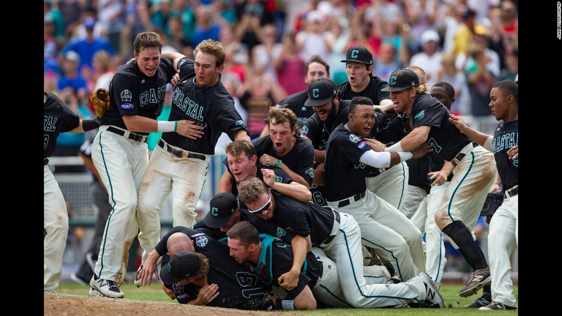 Coastal Carolina players celebrate after winning the College World Series on Thursday, June 30. The Chanticleers defeated Arizona to claim their first-ever national title.