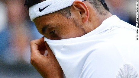 Australia's Nick Kyrgios reacts while playing Britain's Andy Murray during their men's singles fourth round match on the eighth day of the 2016 Wimbledon Championships at The All England Lawn Tennis Club in Wimbledon, southwest London, on July 4, 2016. / AFP / LEON NEAL / RESTRICTED TO EDITORIAL USE        (Photo credit should read LEON NEAL/AFP/Getty Images)