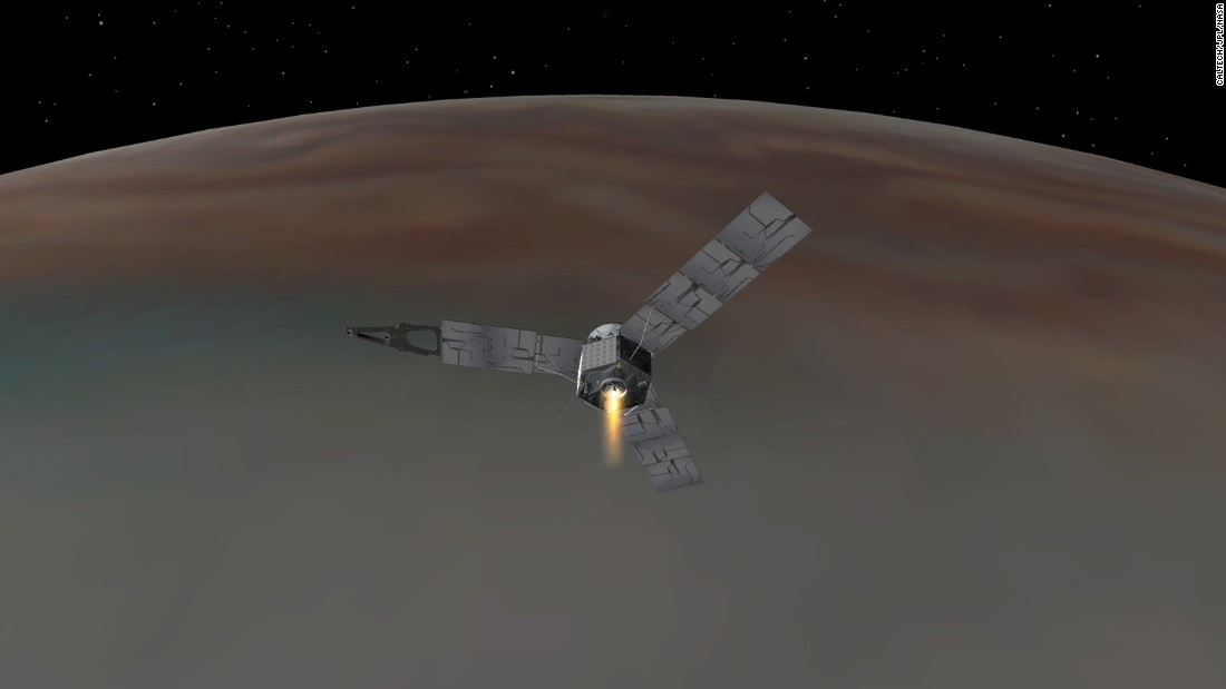 An illustration depicts NASA's Juno spacecraft successfully entering Jupiter's orbit. Juno will study Jupiter from a polar orbit, coming about 3,000 miles (5,000 kilometers) from the cloud tops of the gas giant.