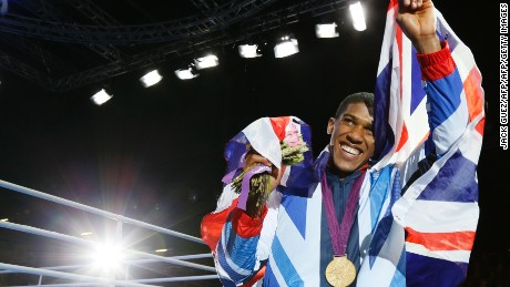 Anthony Joshua of Great Britain celebrates during the awards ceremony for the Super-Heavyweight (+91kg) boxing category of the 2012 London Olympic Games at the ExCel Arena August 12, 2012 in London.   AFP PHOTO / Jack GUEZ        (Photo credit should read JACK GUEZ/AFP/GettyImages)