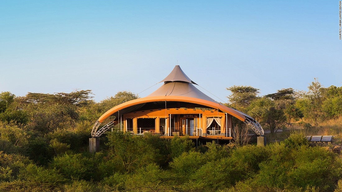 "The architecture alone makes this wilderness retreat a standout: a dozen futuristic ""tents"" designed and fabricated by Nairobi-based canvas maestro Jan Allen and rustic chic interiors by London's Real Studios."