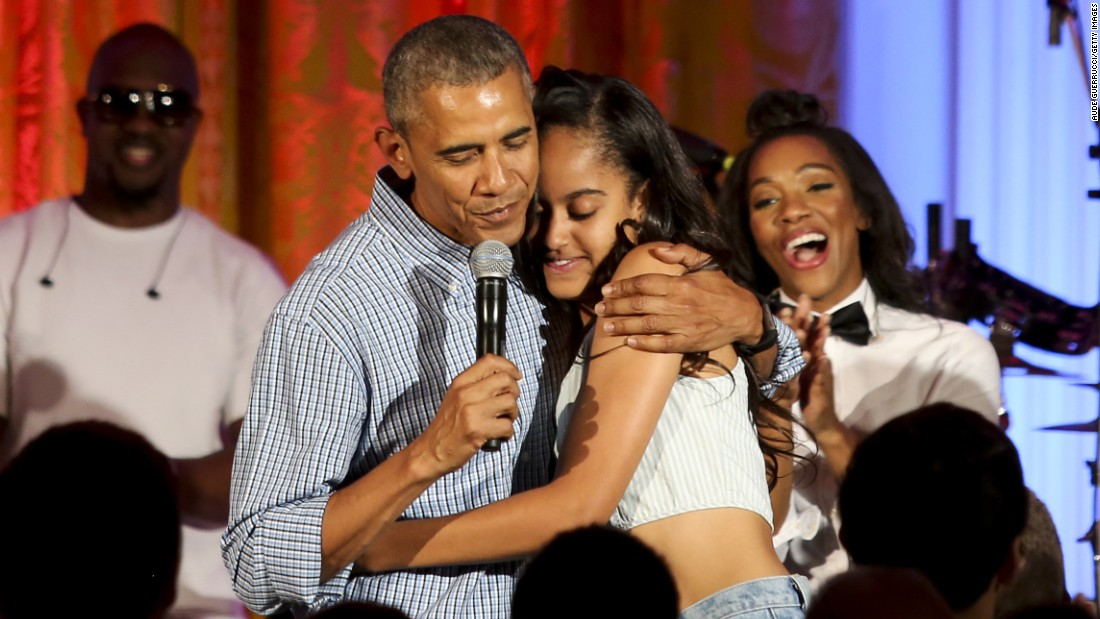 "Obama hugs Malia at the White House Fourth of July party in 2016. She was <a href=""http://www.cnn.com/2016/07/05/politics/obama-malia-birthday-singing/"">celebrating her 18th birthday</a> during the party, which included musicians Janelle Monae and Kendrick Lamar."