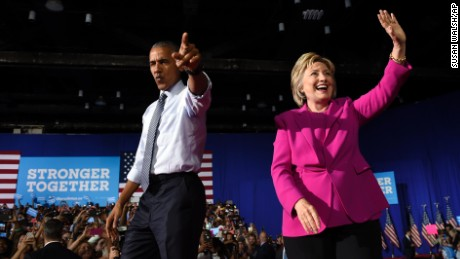 President Barack Obama and Democratic presidential candidate Hillary Clinton wave upon arriving at a campaign event at the Charlotte Convention Center in Charlotte, N.C., Tuesday, July 5, 2016. Obama is spending the afternoon campaigning for Clinton.