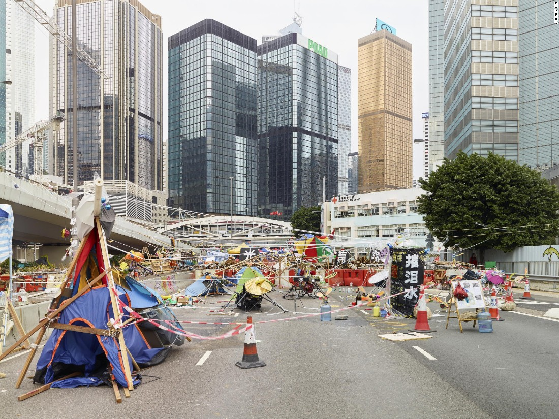 "When Hong Kong's massive Occupy protests took over city streets in 2014, Hong Kong photographer Johnny Gin began creating images of demonstrators' homemade barricades as a ""vernacular expression of protest culture."" For Gin, the structures showed ""how adaptive Hong Kong people are, in terms of making the best out of a very bad situation."""