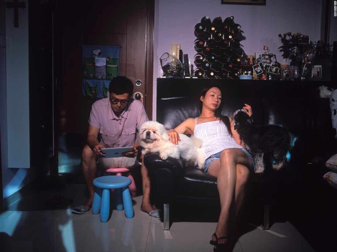 "Singapore-based photographer Wei Leng Tay created pictures of Hong Kongers inside their homes to ""reach out and see what other people were doing with their lives, and how they were handling the spaces and stresses of living in Hong Kong,"" she says. ""The work helps me make sense of... our personal lives and the multiple roles we play."""