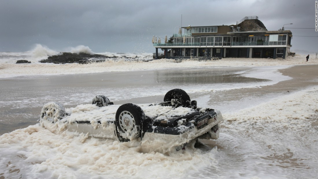 Surf Life Saving Clubs across the nation have to be built to withstand extremes of weather, from searing heat to huge storms. Here, a wave washes over a flipped car near the Currumbin Surf Club building along a stretch of Gold Coast beach in the Australian state of Queensland following a severe storm.