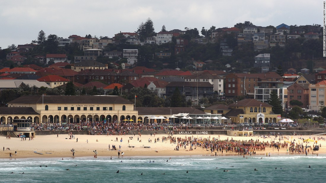 Swimmers prepare to enter the water during the Bondi to Bronte Ocean Swim at Bondi Beach in Sydney, Australia. This annual event is swum over a 2.5 kilometer course between the first two Surf Life Saving clubs in the world.