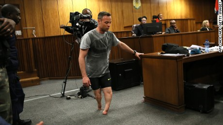 Oscar Pistorius walks on stumps in court