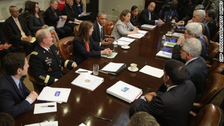 WASHINGTON, DC - OCTOBER 06:  U.S. President Barack Obama talks to members of the news media after a meeting on the Ebola outbreak in West Africa with members of his cabinet and health and security official in the Roosevelt Room at the White House October 6, 2014 in Washington, DC.
