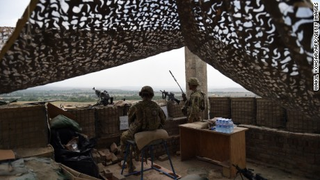 "In this photograph taken on August 12, 2015, US army personnel keep watch at coalition force Forward Operating Base (FOB) Connelly in the Khogyani district in the eastern province of Nangarhar. From his watchtower in insurgency-wracked eastern Afghanistan, US army Specialist Josh Whitten doesn't have much to say about his Afghan colleagues. ""They don't come up here anymore, because they used to mess around with our stuff. ""Welcome to Forward Operating Base Connelly, where US troops are providing training and tactical advice to the 201st Afghan army corps as they take on the Taliban on the battlefield."