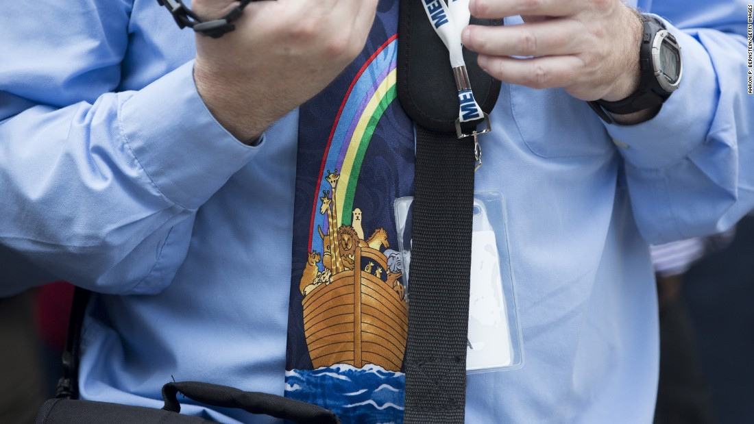 A man wears a Noah's Ark-themed tie at the ribbon-cutting ceremony.