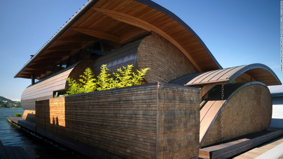 Made with a mix of western red cedar, Douglas Fir and copper, the Randall T. Fennell Residence sits gracefully on the Willamette River in Portland, Oregon. Curving rooftops mimic the ripples in the water below and create an eye-catching silhouette.<br />