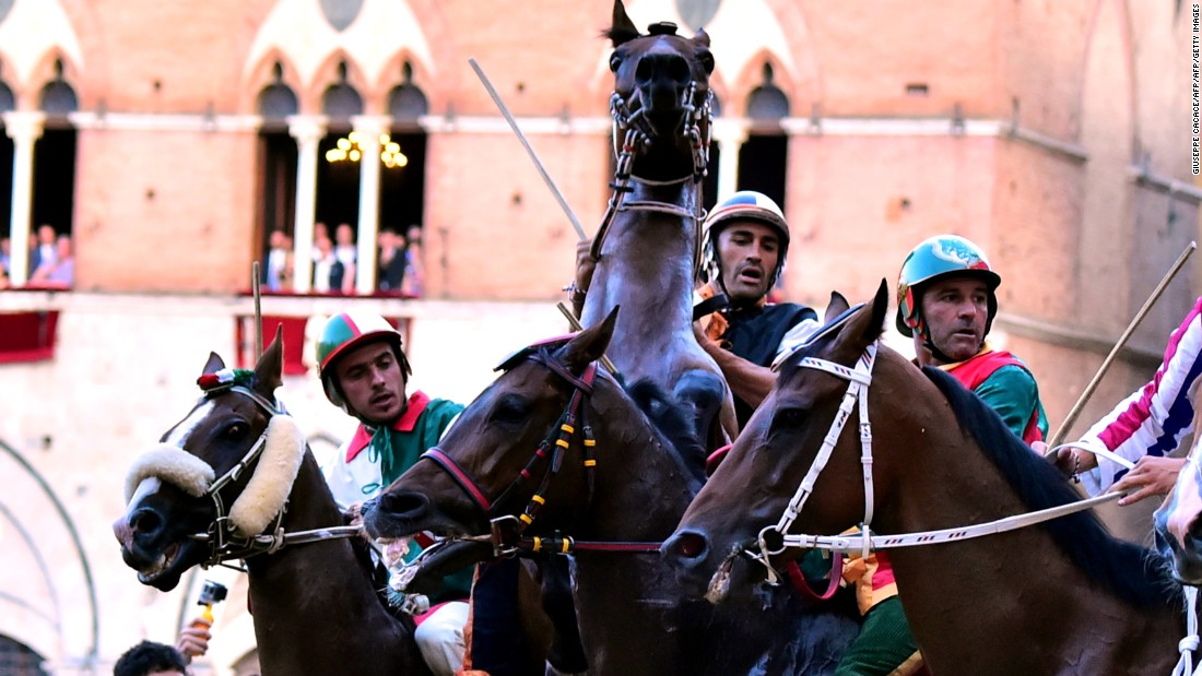 The Palio di Siena horse race takes place twice a year, in July and August, in the central piazza of the Italian city.