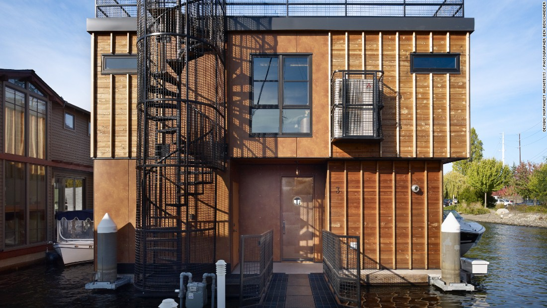 A project by Designs Northwest Architects, Lake Union Float Home is part of Seattle's unique houseboat community. Inspired by the century-old marina warehouses on the docks, the architects created a modern home with historical touches, evident in the industrial form, steel beams, polished concrete and caged spiral staircase.
