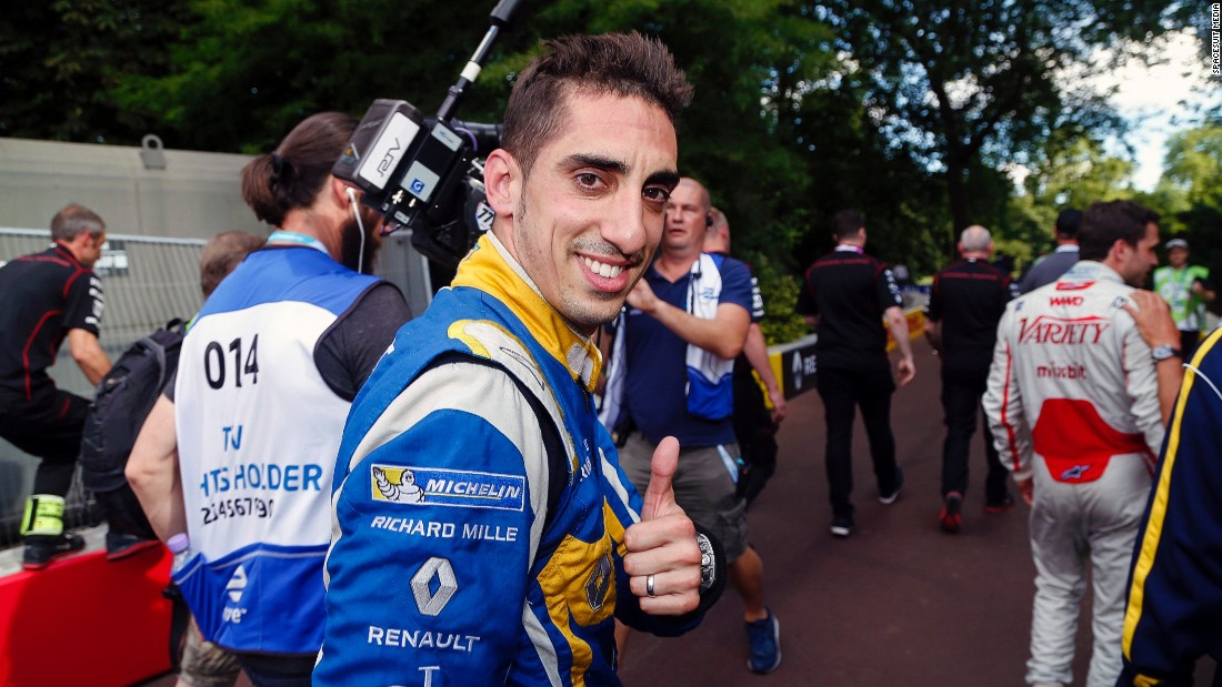 Buemi gives a thumbs up after clinching the world title in London. The Swiss had been trailing di Grassi coming into the final two rounds of the season but sealed the title by recording the fastest lap in the last race picking up the two points he needed to win.
