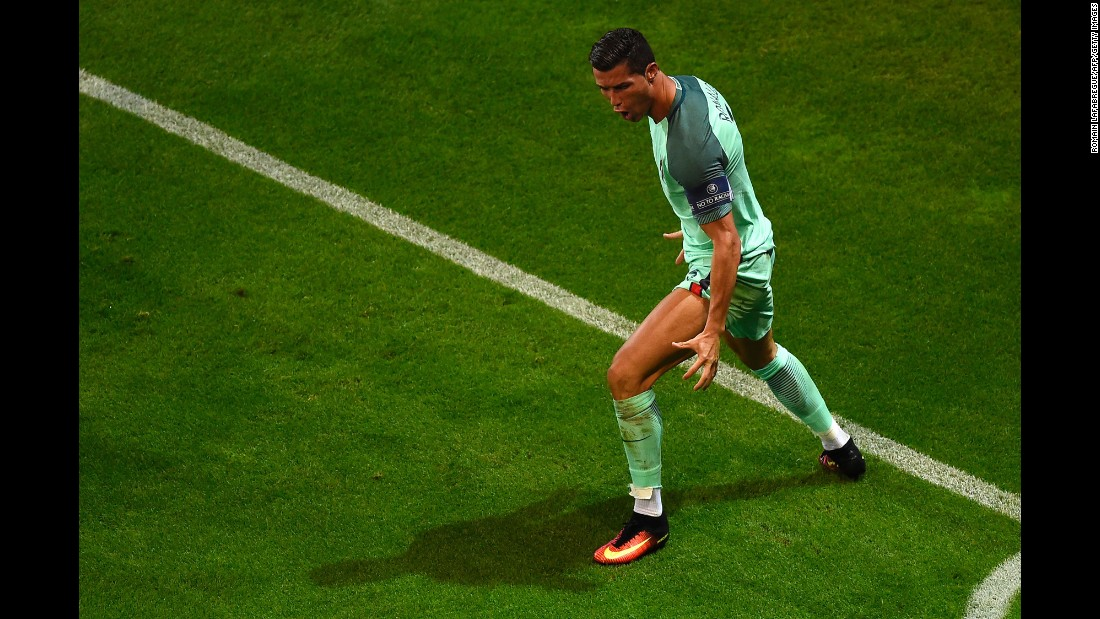 Ronaldo poses after scoring the first goal early in the second half. With the goal, Ronaldo tied Michel Platini for most goals in tournament history (nine).