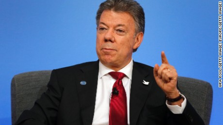 LONDON, ENGLAND - MAY 12: Colombia President Juan Manuel Santos speaks on the podium during a panel discussion at the international anti-corruption summit on May 12, 2016 in London, England. Leaders from many of the worlds nations are gathering in London for the summit, which is aimed at stepping up action to tackle the problem of corruption.  (Photo by Frank Augstein - WPA Pool/Getty Images)