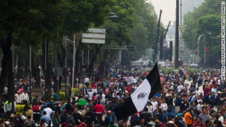 Supporters of Mexican leader of the National Regeneration Movement, Andres Manuel Lopez Obrador, protest in support of the National Coordination of Education Workers (CNTE) teachers' union, and against an education reform launched by the government along Reforma Avenue in Mexico City on June 26, 2016.  / AFP / Hector GUERRERO        (Photo credit should read HECTOR GUERRERO/AFP/Getty Images)