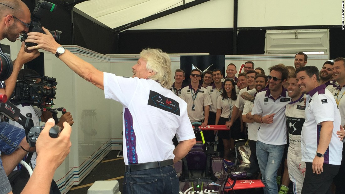 Branson and the Virgin team pose for a team photo ahead of Sunday's final race in London.