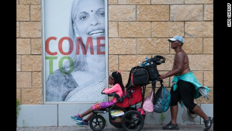 Pushing her daughter in a weighed-down stroller, Paulette Leaphart winds her way out of downtown Charlotte to continue her journey toward Washington.