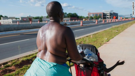 Paulette Leaphart carried no sign and insisted the scars across her chest told her story. She walked along busy roads, like US 29, saying this was how she could be best noticed.