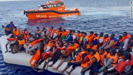 MOAS crews use a smaller boat to rescue migrants before bringing them on board the Topaz Responder.