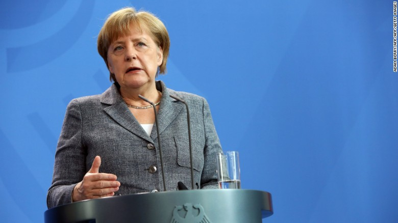 Merkel calls for full veil ban