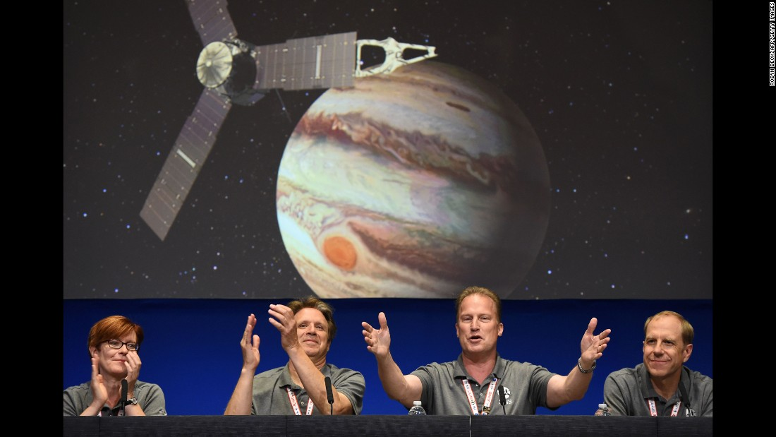 "Officials leading NASA's Juno project celebrate at a news conference after the spacecraft was successfully placed into Jupiter's orbit on Monday, July 4. <a href=""http://www.cnn.com/2016/06/30/health/gallery/juno-at-jupiter/index.html"" target=""_blank"">Juno will study Jupiter from a polar orbit,</a> coming about 3,000 miles (5,000 kilometers) from the cloud tops of the gas giant."